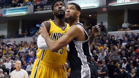 Feb 9, 2015; Indianapolis, IN, USA; San Antonio Spurs center Tim Duncan (21) blocks out for rebounding position against Indiana Pacers center Roy Hibbert (55) at Bankers Life Fieldhouse. Mandatory Credit: Brian Spurlock-USA TODAY Sports