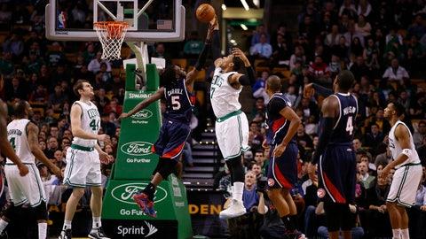 Feb 11, 2015; Boston, MA, USA; Atlanta Hawks forward DeMarre Carroll (5) defends against Boston Celtics forward Jared Sullinger (7) in the first quarter at TD Garden. Mandatory Credit: David Butler II-USA TODAY Sports