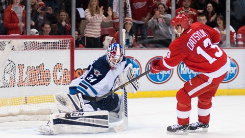 Feb 14, 2015; Detroit, MI, USA; Winnipeg Jets goalie Michael Hutchinson (34) blocks a shot by Detroit Red Wings center Pavel Datsyuk (13) during a shootout at Joe Louis Arena. Winnipeg won 5-4 in a shootout. Mandatory Credit: Tim Fuller-USA TODAY Sports