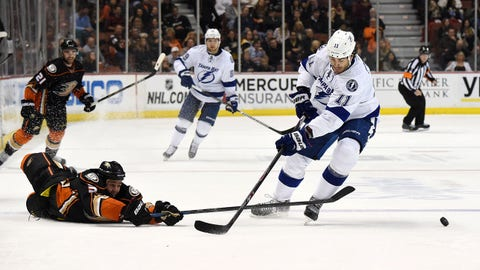 Feb 18, 2015; Anaheim, CA, USA; Tampa Bay Lightning center Brian Boyle (11) and Anaheim Ducks defenseman Clayton Stoner (3) reach for the puck in the third period at Honda Center. The Lightning defeated the Ducks 4-1.  Mandatory Credit: Kirby Lee-USA TODAY Sports