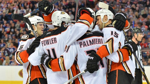 Feb 21, 2015; Edmonton, Alberta, CAN; Anaheim Ducks defenceman Cam Fowler (4) center Ryan Getzlaf (15)  right wing Kyle Palmieri (21) and defenceman Ben Lovejoy (6) celebrate after scoring a goal in the third period against the Edmonton Oilers at Rexall Place. Mandatory Credit: Steve Alkok-USA TODAY Sports