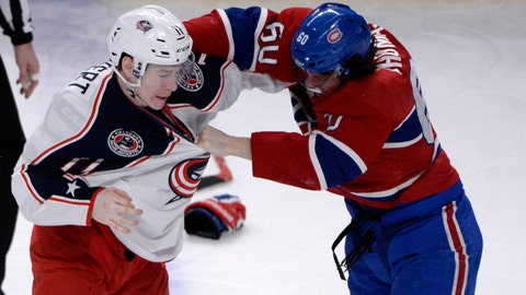 Feb 21, 2015; Montreal, Quebec, CAN; Columbus Blue Jackets forward Matt Calvert (11) fights with Montreal Canadiens forward Christian Thomas (60) during the third period at the Bell Centre. Mandatory Credit: Eric Bolte-USA TODAY Sports