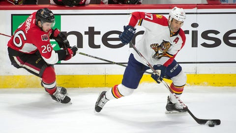 Feb 21, 2015; Ottawa, Ontario, CAN; Florida Panthers center Derek MacKenzie (17) skates with the puck in front of Ottawa Senators left wing Matt Puempel (26) in the third period at the Canadian Tire Centre. The Senators defeated the Panthers 4-1. Mandatory Credit: Marc DesRosiers-USA TODAY Sports