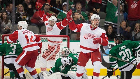 Feb 21, 2015; Dallas, TX, USA; Detroit Red Wings center Gustav Nyquist (14) and center Pavel Datsyuk (13) and left wing Justin Abdelkader (8) celebrate the game tying goal against Dallas Stars goalie Kari Lehtonen (32) during the third period at the American Airlines Center.The Red Wings defeated the Stars 7-6 in overtime. Mandatory Credit: Jerome Miron-USA TODAY Sports