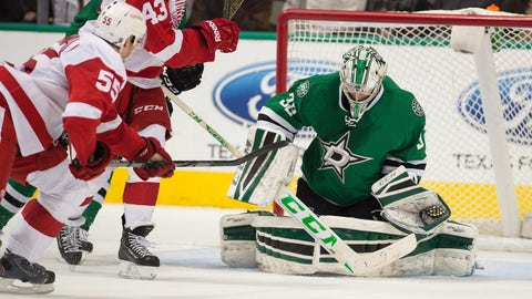 Feb 21, 2015; Dallas, TX, USA; Detroit Red Wings defenseman Niklas Kronwall (55) scores the game winning goal against Dallas Stars goalie Kari Lehtonen (32) during the overtime period at the American Airlines Center.The Red Wings defeated the Stars 7-6 in overtime. Mandatory Credit: Jerome Miron-USA TODAY Sports