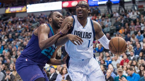 Feb 22, 2015; Dallas, TX, USA; Charlotte Hornets center Al Jefferson (25) guards Dallas Mavericks center Amar'e Stoudemire (1) during the first half at the American Airlines Center. Mandatory Credit: Jerome Miron-USA TODAY Sports