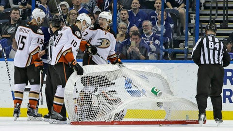 Anaheim Ducks center Ryan Getzlaf (15), right wing Corey Perry (10) and defenseman Hampus Lindholm (47), of Sweden, check on goalie Frederik Andersen (31), of Denmark, after the goal tipped over on him during the third period of an NHL hockey game Sunday, Feb. 8, 2015, in Tampa, Fla. Andersen left the game. (AP Photo/Chris O'Meara)