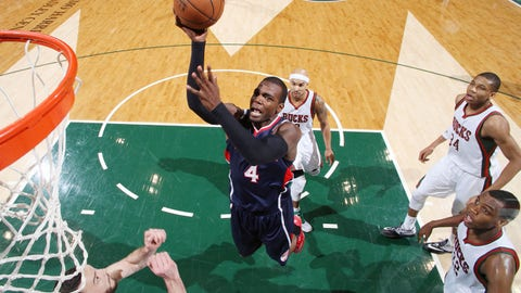 MILWAUKEE, WI - FEBRUARY 22: Paul Millsap #4 of the Atlanta Hawks goes for the basket against the Milwaukee Bucks during the game on February 22, 2015 at BMO Harris Bradley Center in Milwaukee, Wisconsin. NOTE TO USER: User expressly acknowledges and agrees that, by downloading and/or using this photograph, User is consenting to the terms and conditions of the Getty Images License Agreement. Mandatory Copyright Notice: Copyright 2015 NBAE (Photo by Gary Dineen/NBAE via Getty Images)