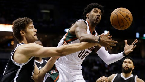 Milwaukee Bucks' O.J. Mayo and Brooklyn Nets' Brook Lopez go after a loose ball during the second half of an NBA basketball game Monday, Feb. 9, 2015, in Milwaukee. (AP Photo/Morry Gash)