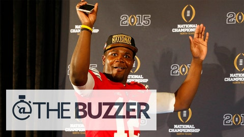 Jan 12, 2015; Arlington, TX, USA; Ohio State Buckeyes quarterback Cardale Jones (12) walks into a press conference after beating the Oregon Ducks in the 2015 CFP National Championship Game at AT&T Stadium. Mandatory Credit: Tim Heitman-USA TODAY Sports