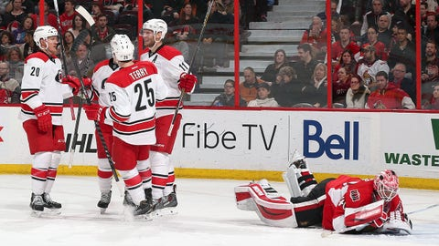 OTTAWA, ON - FEBRUARY 16: Riley Nash #20, Chris Terry #25 and Jordan Staal #11 of the Carolina Hurricanes celebrate a second period goal against Robin Lehner #40 of the Ottawa Senators at Canadian Tire Centre on February 16, 2015 in Ottawa, Ontario, Canada.  (Photo by Andre Ringuette/NHLI via Getty Images)