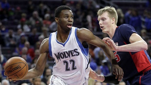 Minnesota Timberwolves' Andrew Wiggins (22) looks to pass the ball against Detroit Pistons' Kyle Singler, right, during the first half of an NBA basketball game Sunday, Feb. 8, 2015, in Auburn Hills, Mich. (AP Photo/Duane Burleson)