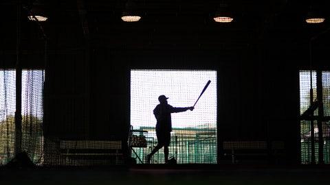Atlanta Braves' Eric Young Jr. takes batting practice during an informal spring training baseball workout, Friday, Feb. 20, 2015, in Kissimmee, Fla. (AP Photo/David Goldman)
