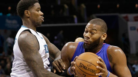 Detroit Pistons' Greg Monroe, right, drives against Charlotte Hornets' Marvin Williams, left, during the second half of an NBA basketball game in Charlotte, N.C., Tuesday, Feb. 10, 2015. The Pistons won 106-78. (AP Photo/Chuck Burton)