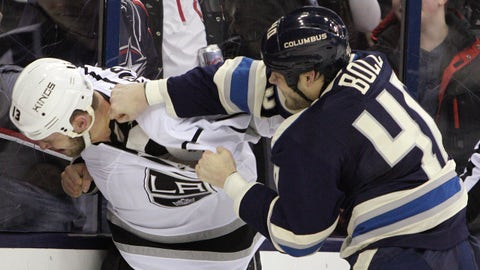 Los Angeles Kings' Kyle Clifford, left, and Columbus Blue Jackets' Jared Boll fight during the first period of an NHL hockey game Monday, Feb. 9, 2015, in Columbus, Ohio. (AP Photo/Jay LaPrete)