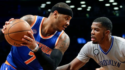 Brooklyn Nets' Joe Johnson (7) defends New York Knicks' Carmelo Anthony (7) during the first half of an NBA basketball game Friday, Feb. 6, 2015, in New York. (AP Photo/Frank Franklin II)