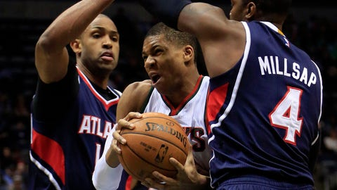 Milwaukee Bucks forward Giannis Antetokounmpo, center, is defended by Atlanta Hawks center Al Horford, left, and Paul Millsap, right, during the first half of an NBA basketball game Sunday, Feb. 22, 2015, in Milwaukee. (AP Photo/Darren Hauck)