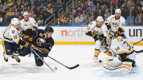 BUFFALO, NY - FEBRUARY 22: Marcus Foligno #82 of the Buffalo Sabres gets a shot off against Carter Hutton #30 of the Nashville Predators while defended by Michael Santorelli #10 of the Predators on February 22, 2015 at the First Niagara Center in Buffalo, New York.  (Photo by Bill Wippert/NHLI via Getty Images)