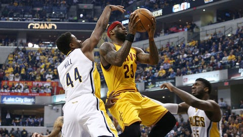 Feb 6, 2015; Indianapolis, IN, USA; Cleveland Cavaliers forward LeBron James (23) takes a shot against Indiana Pacers forward Solomon Hill (44) at Bankers Life Fieldhouse. Mandatory Credit: Brian Spurlock-USA TODAY Sports