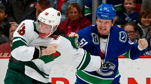 VANCOUVER, BC - FEBRUARY 1:  Ryan Carter #18 of the Minnesota Wild and Derek Dorsett #51 of the Vancouver Canucks fight during their NHL game at Rogers Arena February 1, 2015 in Vancouver, British Columbia, Canada.  (Photo by Jeff Vinnick/NHLI via Getty Images)