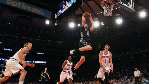 Mar 19, 2015; New York, NY, USA; Minnesota Timberwolves small forward Chase Budinger (10) dunks against New York Knicks power forward Lou Amundson (21) and point guard Langston Galloway (2) and point guard Alexey Shved (1) during the second quarter at Madison Square Garden. Mandatory Credit: Brad Penner-USA TODAY Sports