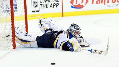 Mar 19, 2015; Winnipeg, Manitoba, CAN; St. Louis Blues goalie Brian Elliott (1) jumps at a loose puck during the third period against the Winnipeg Jets at MTS Centre. Winnipeg Jets wins 2-1. Mandatory Credit: Bruce Fedyck-USA TODAY Sports