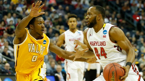 Mar 20, 2015; Columbus, OH, USA; Maryland Terrapins guard/forward Dez Wells (44) dribbles the ball while guarded by Valparaiso Crusaders guard Keith Carter (0) during the second half in the second round of the 2015 NCAA Tournament at Nationwide Arena. Mandatory Credit: Greg Bartram-USA TODAY Sports