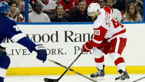Mar 20, 2015; Tampa, FL, USA; Detroit Red Wings left wing Henrik Zetterberg (40) passes the puck against the Tampa Bay Lightning during the third period at Amalie Arena. Tampa Bay Lightning defeated the Detroit Red Wings 3-1. Mandatory Credit: Kim Klement-USA TODAY Sports