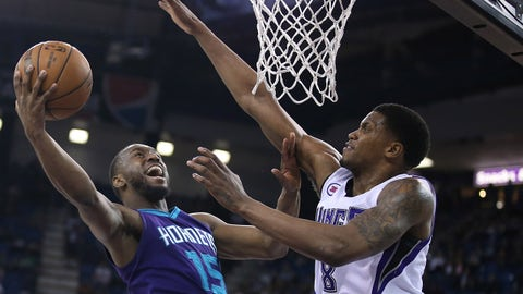 Mar 20, 2015; Sacramento, CA, USA; Sacramento Kings forward Rudy Gay (8) defends the shot by Charlotte Hornets guard Kemba Walker (15) during the second quarter at Sleep Train Arena. Mandatory Credit: Kelley L Cox-USA TODAY Sports