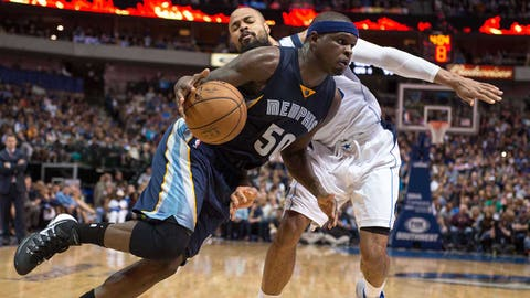 Mar 20, 2015; Dallas, TX, USA; Memphis Grizzlies forward Zach Randolph (50) drives to the basket past Dallas Mavericks center Tyson Chandler (6) during the second half at the American Airlines Center. Randolph leads his team with 21 points. The Grizzlies defeated the Mavericks 112-101. Mandatory Credit: Jerome Miron-USA TODAY Sports