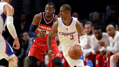 Mar 20, 2015; Los Angeles, CA, USA; Los Angeles Clippers guard Chris Paul (3) moves the ball as he is defended by Washington Wizards guard John Wall (back) during the first quarter at Staples Center. Mandatory Credit: Kelvin Kuo-USA TODAY Sports