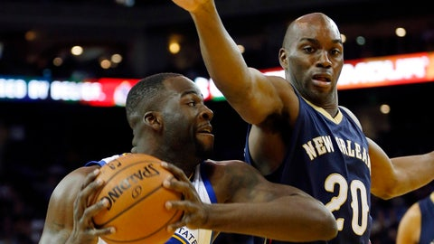 Mar 20, 2015; Oakland, CA, USA; Golden State Warriors forward Draymond Green (23) fights for position under the basket while defended by New Orleans Pelicans guard Quincy Pondexter (20) during the first quarter at Oracle Arena. Mandatory Credit: Bob Stanton-USA TODAY Sports
