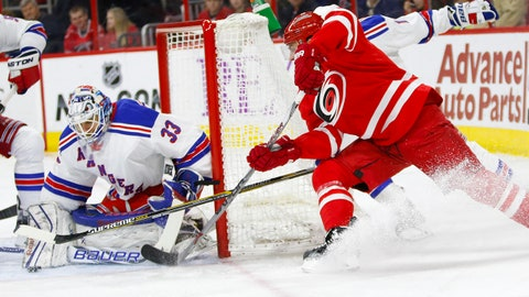 Mar 21, 2015; Raleigh, NC, USA; Carolina Hurricanes forward Patrick Dwyer (39) is stopped on the shot by the New York Rangers goalie Cam Talbot (33) during the 2nd period at PNC Arena. Mandatory Credit: James Guillory-USA TODAY Sports