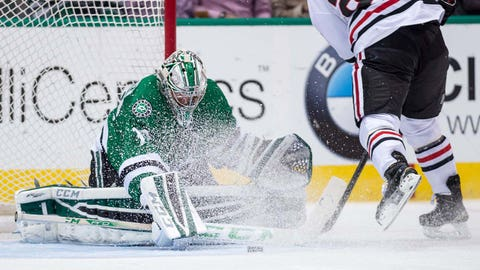 Mar 21, 2015; Dallas, TX, USA; Dallas Stars goalie Kari Lehtonen (32) stops Chicago Blackhawks left wing Brandon Saad (20) on a penalty shot during the third period at the American Airlines Center. The Stars shut out the Blackhawks 4-0. Mandatory Credit: Jerome Miron-USA TODAY Sports