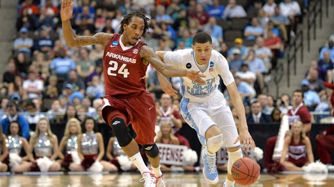 Mar 21, 2015; Jacksonville, FL, USA; Arkansas Razorbacks guard Michael Qualls (24) pressures North Carolina Tar Heels guard/forward Justin Jackson (44) in the second half of a game in the third round of the 2015 NCAA Tournament at Jacksonville Veterans Memorial Arena. Mandatory Credit: Tommy Gilligan-USA TODAY Sports