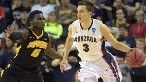 March 22, 2015; Seattle, WA, USA; Gonzaga Bulldogs guard Kyle Dranginis (3) moves the ball against Iowa Hawkeyes guard Anthony Clemmons (5) during the second half in the third round of the 2015 NCAA Tournament at KeyArena. Mandatory Credit: Kirby Lee-USA TODAY Sports