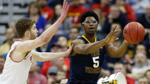Mar 22, 2015; Columbus, OH, USA; West Virginia Mountaineers forward Devin Williams (5) passes while guarded by Maryland Terrapins forward Jake Layman (10) during the second half in the third round of the 2015 NCAA Tournament at Nationwide Arena. West Virginia won 69-59. Mandatory Credit: Joe Maiorana-USA TODAY Sports