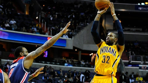Mar 25, 2015; Washington, DC, USA; Indiana Pacers guard C.J. Watson (32) shoots a jumper as Washington Wizards forward Rasual Butler (8) defends during the first half at Verizon Center. Mandatory Credit: Brad Mills-USA TODAY Sports