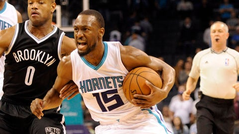 Mar 25, 2015; Charlotte, NC, USA; Charlotte Hornets guard Kemba Walker (15) drives to the basket past Brooklyn Nets guard Jarrett Jack (0) during the second half of the game at Time Warner Cable Arena. Nets win 91-88. Mandatory Credit: Sam Sharpe-USA TODAY Sports