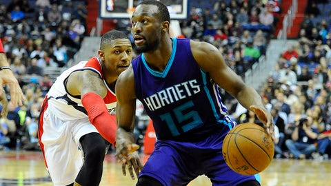 Mar 27, 2015; Washington, DC, USA; Charlotte Hornets guard Kemba Walker (15) dribbles the ball as Washington Wizards guard Bradley Beal (3) defends during the second half at Verizon Center. The Wizards won in double overtime 110 - 107. Mandatory Credit: Brad Mills-USA TODAY Sports