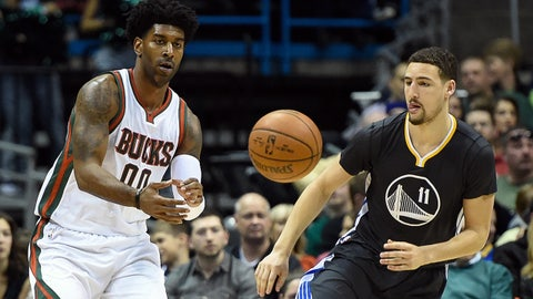 Mar 28, 2015; Milwaukee, WI, USA;Milwaukee Bucks guard O.J. Mayo (00) gets a pass against Golden State Warriors guard Klay Thompson (11) in the second quarter at BMO Harris Bradley Center. Mandatory Credit: Benny Sieu-USA TODAY Sports