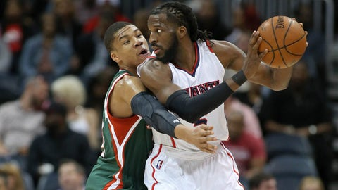 Mar 30, 2015; Atlanta, GA, USA; Milwaukee Bucks forward Giannis Antetokounmpo (34) guards Atlanta Hawks forward DeMarre Carroll (5) in the first quarter of their game at Philips Arena. Mandatory Credit: Jason Getz-USA TODAY Sports