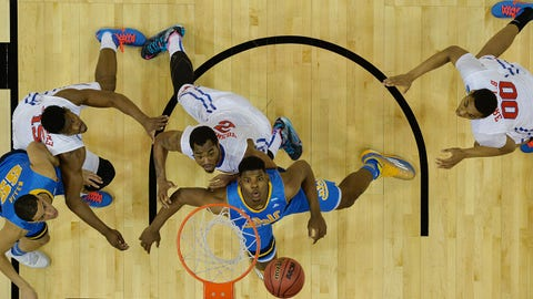 Mar 19, 2015; Louisville, KY, USA; Southern Methodist Mustangs players Ben Emelogu (21) Markus Kennedy (5) and Ben Moore (0) and UCLA Bruins players Tony Parker (23) and Noah Allen (22) watch the ball during the first half in the second round of the 2015 NCAA Tournament at KFC Yum! Center. Mandatory Credit: Jamie Rhodes-USA TODAY Sports