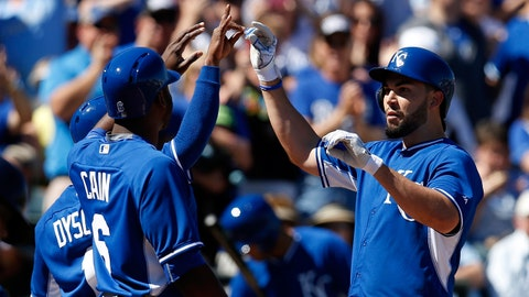 Mar 4, 2015; Surprise, AZ, USA; Kansas City Royals first baseman Eric Hosmer (35) celebrates with Lorenzo Cain (6) and Jarrod Dyson (1) after hitting a three run home run in the first inning during a spring training baseball game against the Texas Rangers at Surprise Stadium. Mandatory Credit: Rick Scuteri-USA TODAY Sports