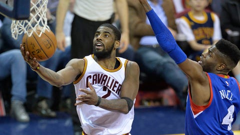 Mar 29, 2015; Cleveland, OH, USA; Cleveland Cavaliers guard Kyrie Irving (2) drives against Philadelphia 76ers center Nerlens Noel (4) in the fourth quarter at Quicken Loans Arena. Mandatory Credit: David Richard-USA TODAY Sports