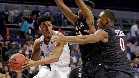 Duke's Quinn Cook, left, looks to pass as San Diego State's Skylar Spencer, right, and Malik Pope, back, defend during the second half of an NCAA tournament college basketball game in Charlotte, N.C., Sunday, March 22, 2015. (AP Photo/Nell Redmond)