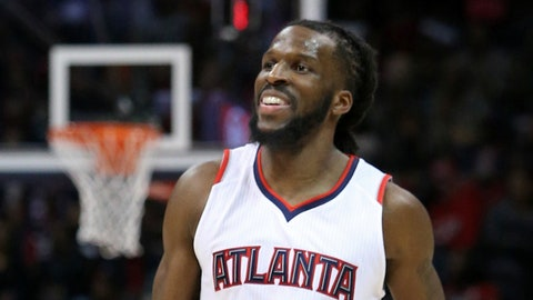 Mar 27, 2015; Atlanta, GA, USA; Atlanta Hawks forward DeMarre Carroll (5) reacts to his three-point attempt in the fourth quarter of their game against the Miami Heat at Philips Arena. The Hawks won 99-86. Mandatory Credit: Jason Getz-USA TODAY Sports