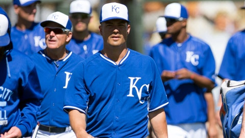 Mar 10, 2015; Surprise, AZ, USA; Kansas City Royals pitcher Jeremy Guthrie (11) walks to the dugout during a spring training baseball game against the Chicago White Sox at Surprise Stadium. The White Sox beat the Royals 6-2.  Mandatory Credit: Allan Henry-USA TODAY Sports