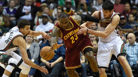 Mar 22, 2015; Milwaukee, WI, USA;  Cleveland Cavaliers forward LeBron James (23) chases a loose ball against Milwaukee Bucks guard Michael Carter-Williams (5) and forward Ersan Ilyasova (7) in the fourth quarter at BMO Harris Bradley Center. Mandatory Credit: Benny Sieu-USA TODAY Sports