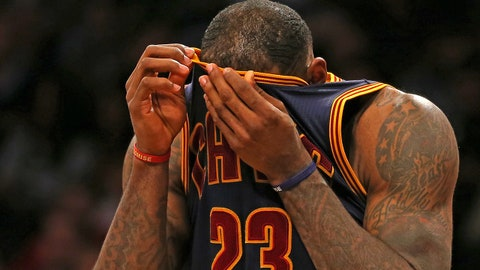 Mar 27, 2015; Brooklyn, NY, USA; Cleveland Cavaliers forward LeBron James (23) wipes his face against the Brooklyn Nets during the second half at Barclays Center. The Nets defeated the Cavaliers 106 - 98. Mandatory Credit: Adam Hunger-USA TODAY Sports